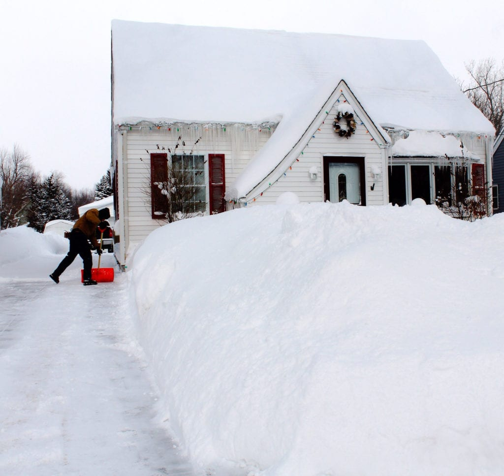 Man Shoveling snow at front of his house